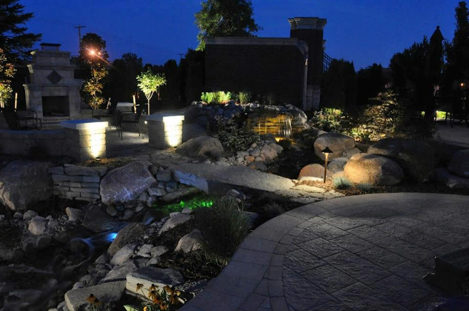 Outdoor Fireplace And Waterfall In Macomb Twp Mi At Night
